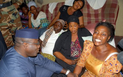 Ekiti State Governor, Dr Kayode Fayemi with the widows of the slain former chairman of NURTW, Omolafe Aderiye, Kehinde (left) and Funmilayo (right) and other family members when the governor paid a condolence visit to the residence of the late drivers' union leader in Ado-Ekiti